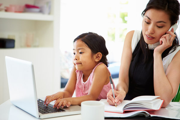 Stressed woman working with daughter
